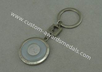 China 1 1/2 Inch Zinc Alloy Promotional Key Chain With Porcelain Piece Inserted , Silver Plating supplier